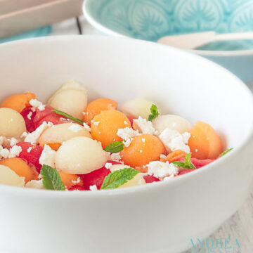 Three colors melon salad with goat cheese and mint