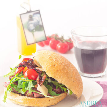 Sandwich with grilled steak and caramelized onions