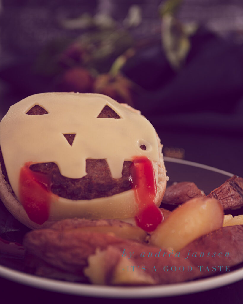 Cheeseburger with homemade oven-baked fries for Halloween