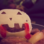 pin Cheeseburger with homemade oven-baked fries for Halloween