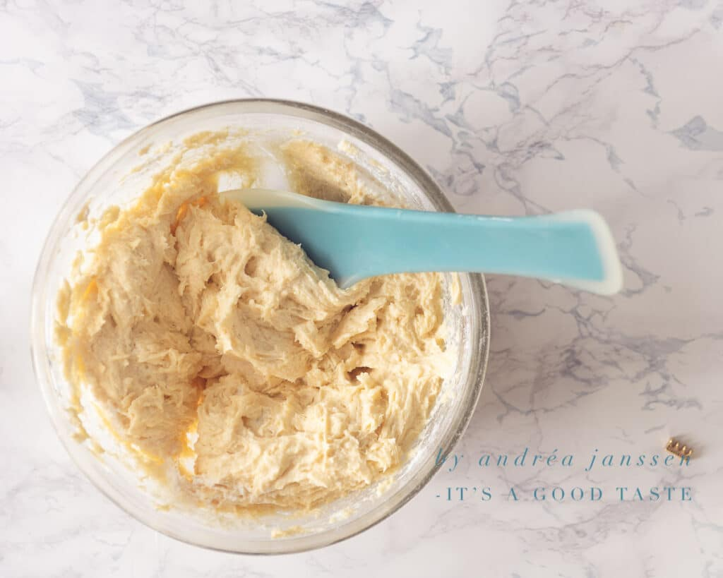 Mix the ricotta into the batter with a spatula