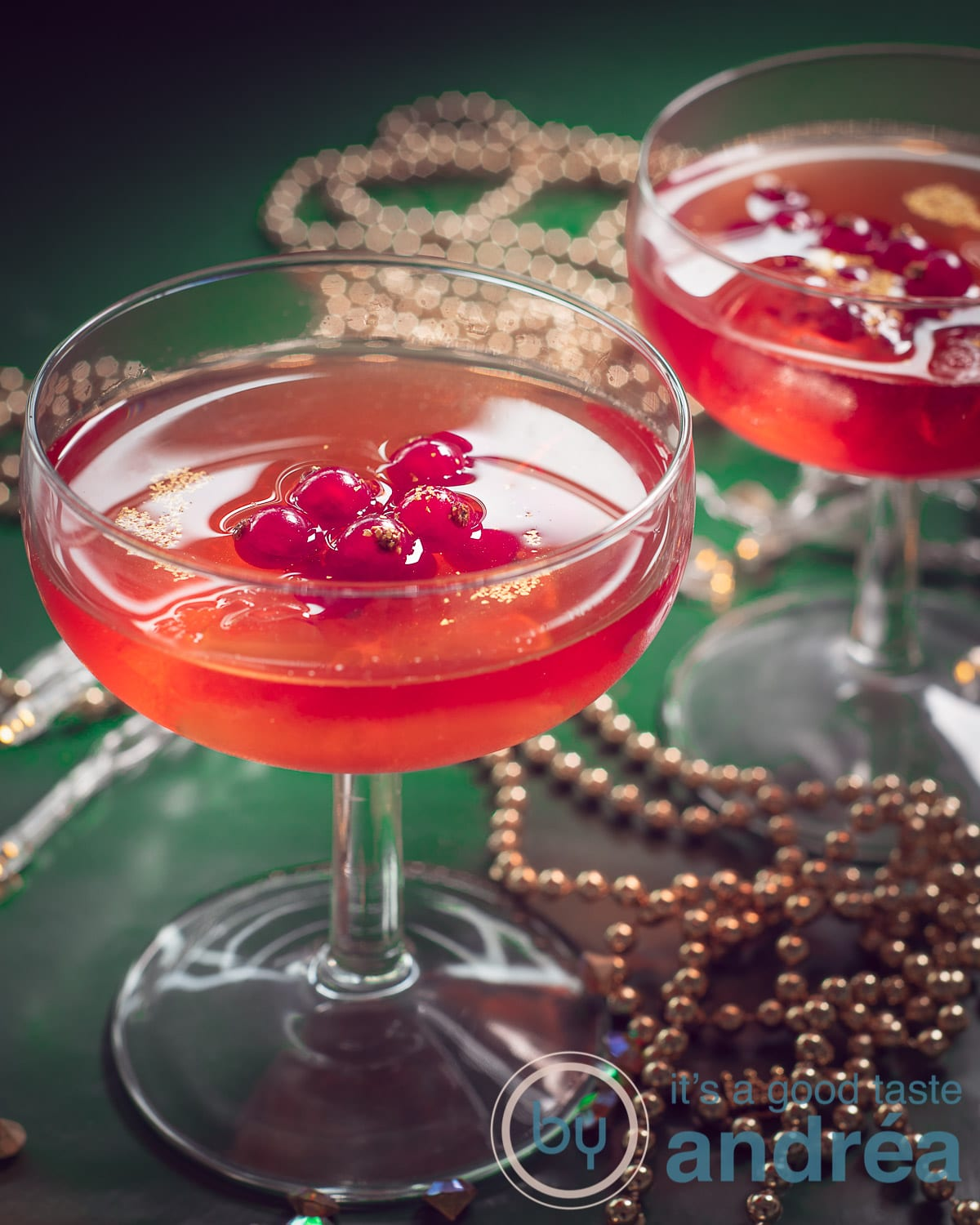 Two glasses filled with Cosmopolitan cocktail recipe with red currants