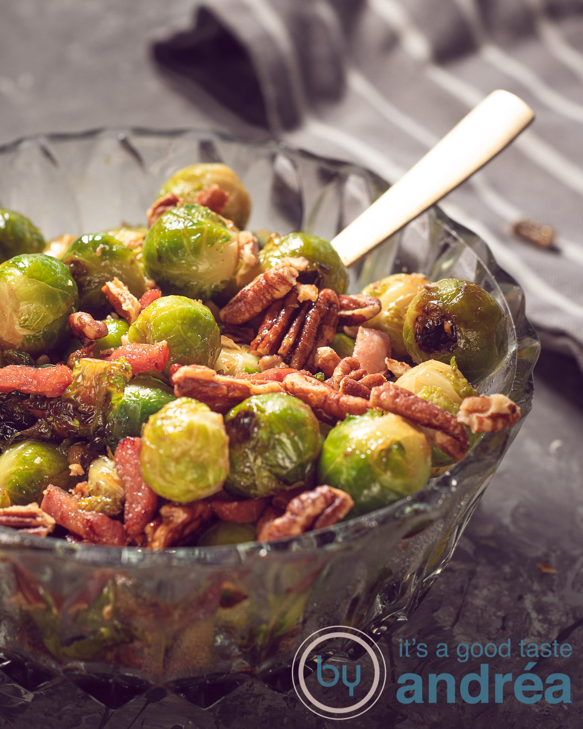 A bowl with Brussels sprouts, bacon and pecans