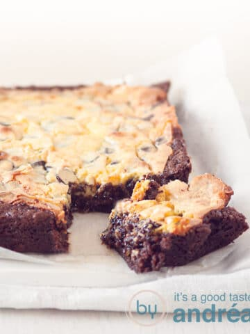 Cheesecake brownie with a square loose at the bottom on a baking paper