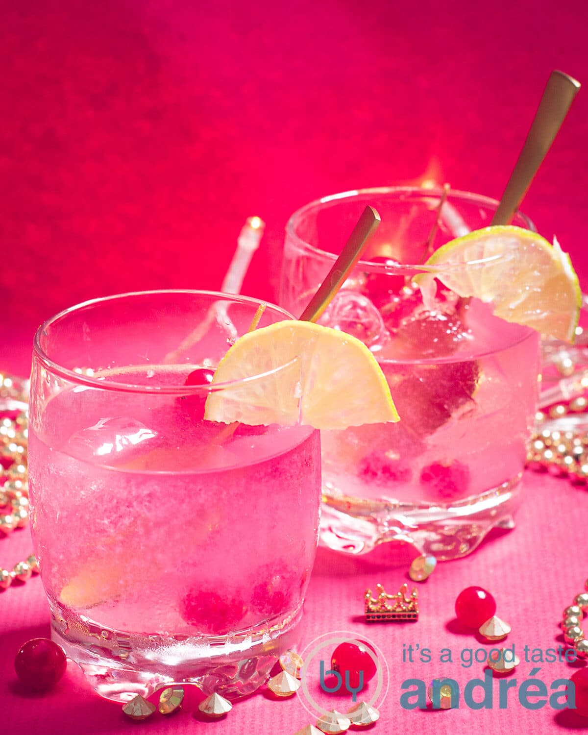 Two glasses of Caipirinha with red currants on a red background