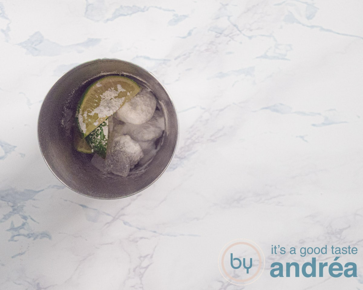 cocktail shaker with lime and confectioners sugar
