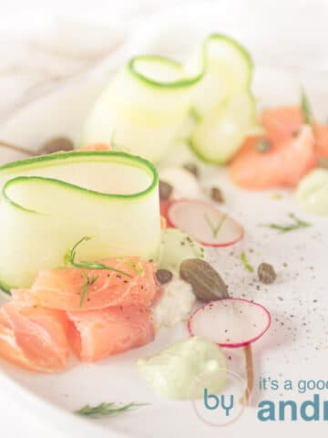 square picture of smoked salmon, cucumber ribbons and cream