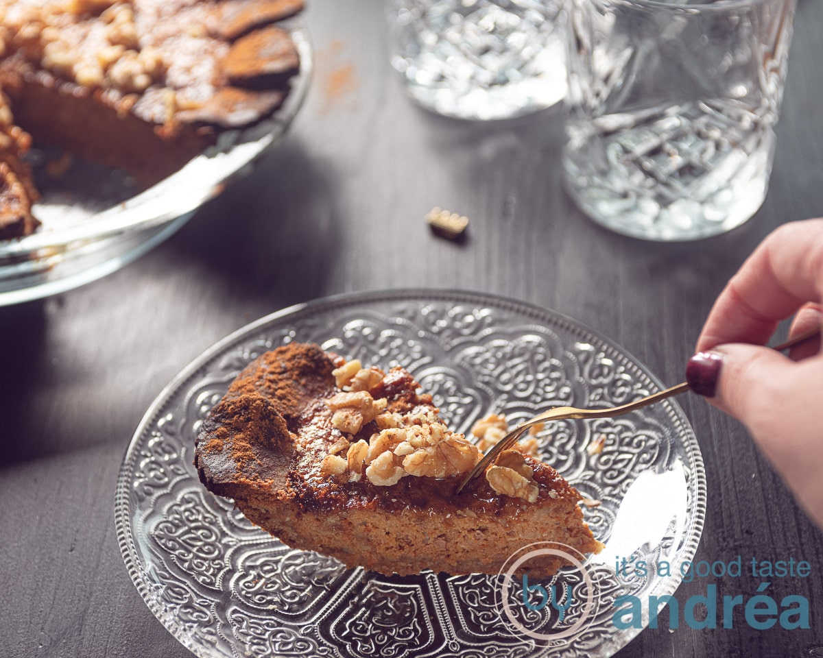 a piece of pumpkin tart where someone takes a bite out
