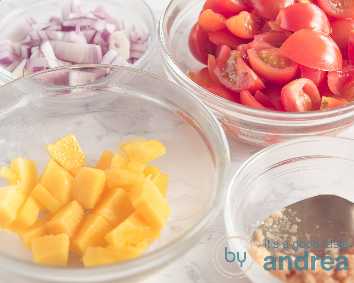 bowls with ingredients prepped, mango, garlic, onion and tomatoes