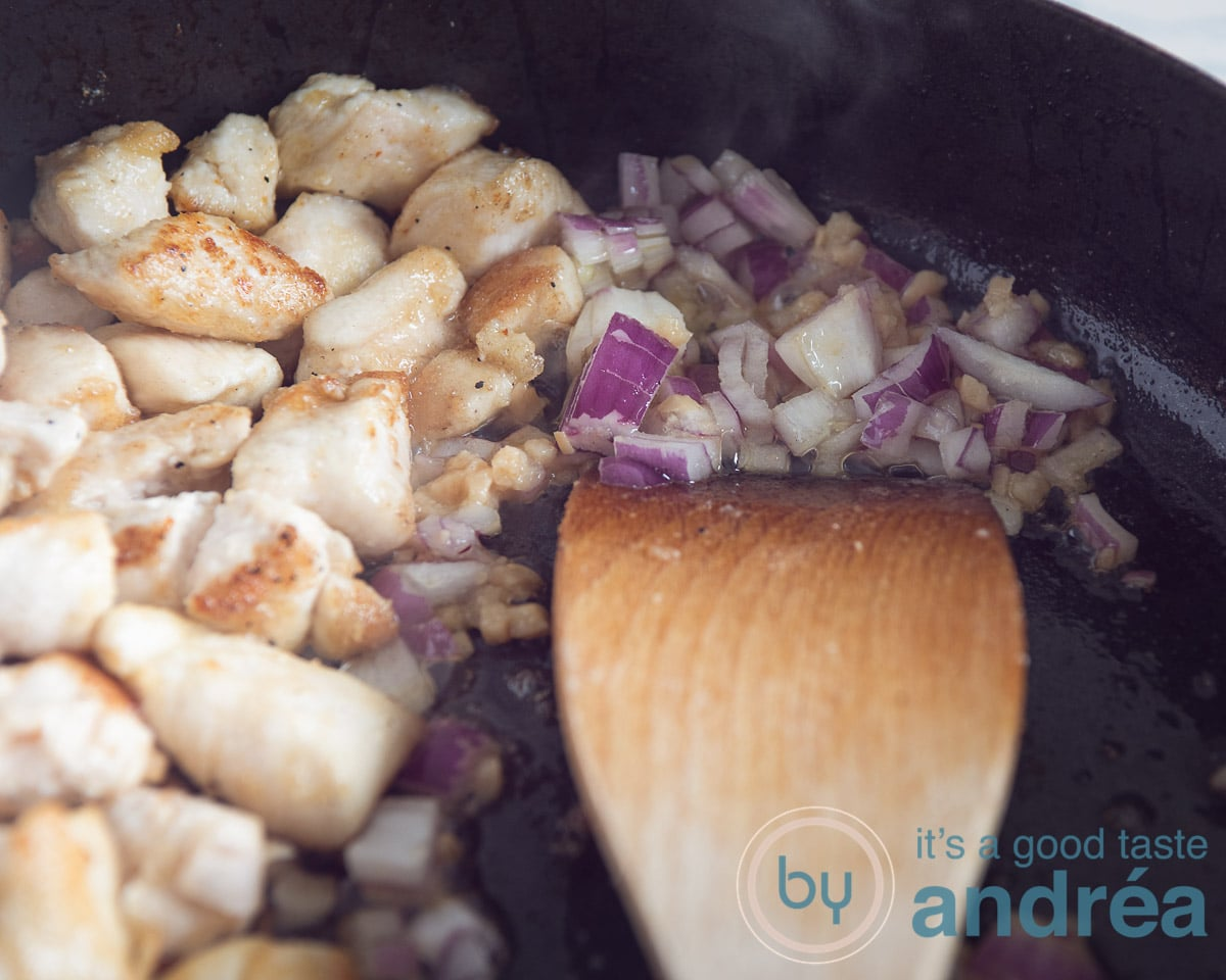 baked chicken and stir-frying onion and garlic
