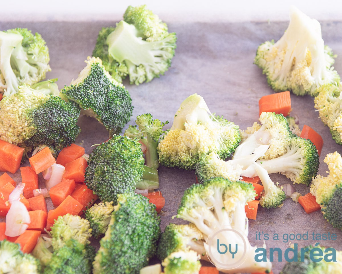 Carrot, broccoli and onions on a baking sheet