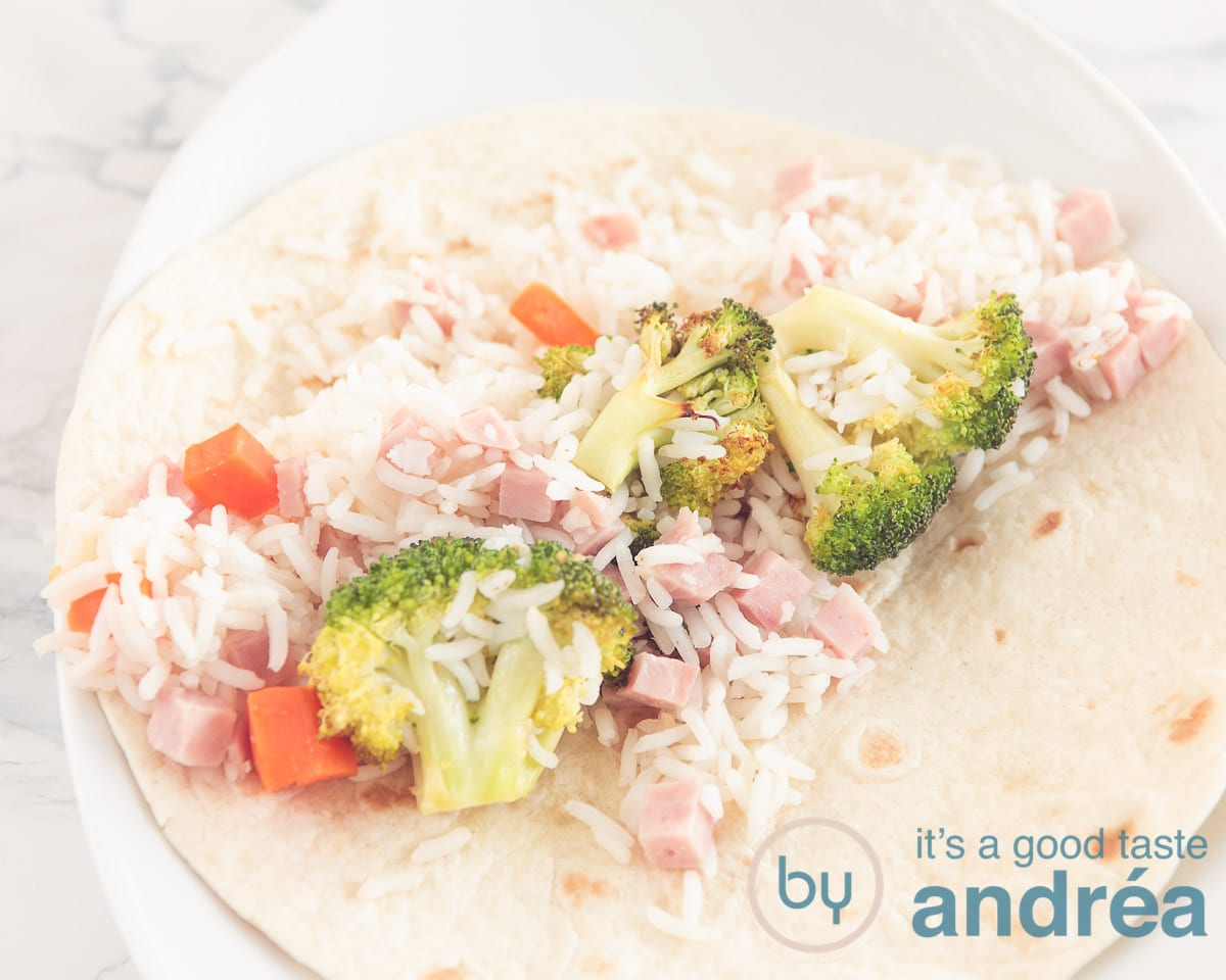 wrap with filling of carrot, rice, broccoli and ham