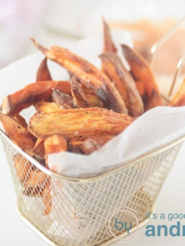 A square photo with a bowl filled with sweet potato fries